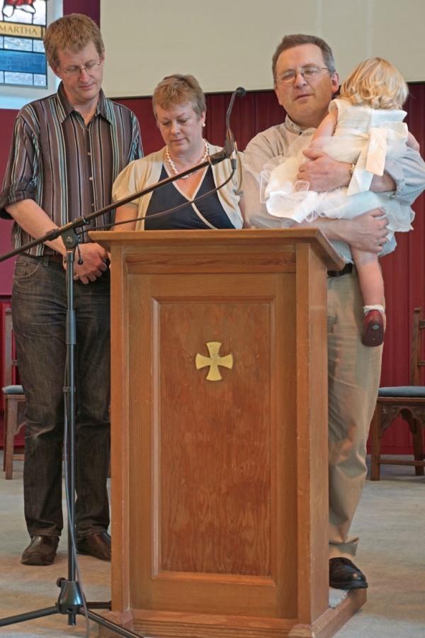 Pastor Nick dedicating child